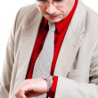 Man looks at his watch — Stock Photo