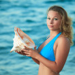 Woman with seashell — Stock Photo
