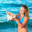 Woman with seashell — Stock Photo #2995063