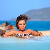 Woman in swimming pool — Foto de Stock
