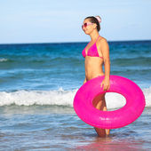 Woman with inner tube — Stockfoto