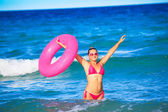 Woman with inner tube — Stock Photo