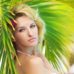 Woman near palm tree — Stock Photo #3717499