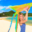 Woman with kite - Stockfoto