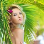 Woman near palm tree — Stock Photo #3814908