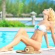 Woman near swimming pool — Stock Photo