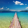 Wooden pier in tropical paradise — Stock Photo
