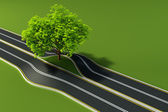 Tree in the middle of road — Stock Photo