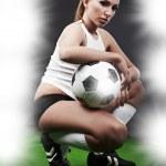 Sexy football player on stadium — Stock Photo