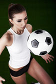 Sexy football player on stadium — Stock Photo