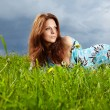 Beautiful  woman on field in summer — Stock Photo