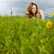 Woman lying on the grass in the summer — Stock Photo