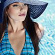 Young sexy woman in the pool — Stock Photo