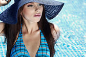Young sexy woman in the pool — Stockfoto