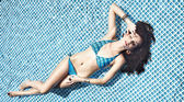 Beautiful young woman at a pool — Stok fotoğraf