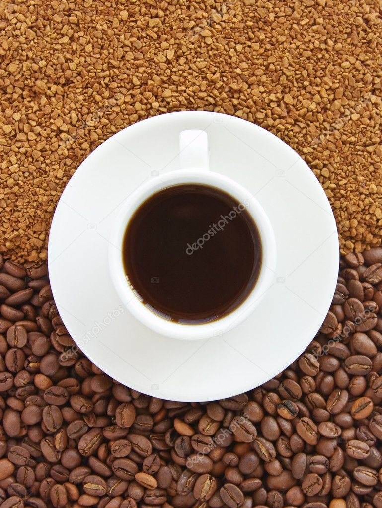 Background from coffee grains and soluble coffee and also cup of coffee  Stock Photo #2887738