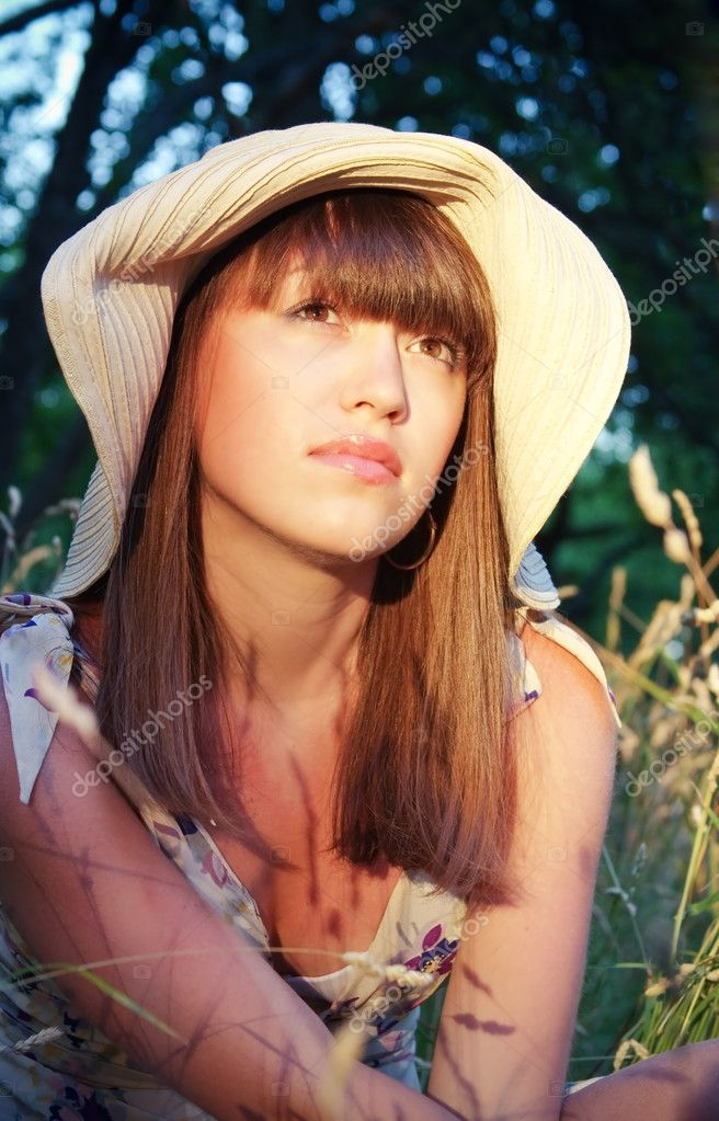 Thoughtful girl in a hat on nature  Stock Photo #3356835