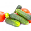 Fresh cucumbers and tomatoes isolated on the white — Stock Photo
