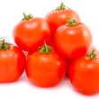 Hill of Cherry tomatoes on white — Stock Photo