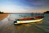 Boats in sunset sea — Stock Photo