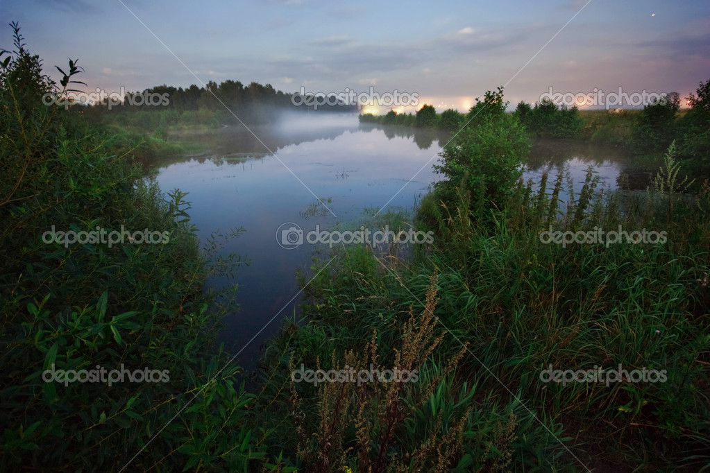After sunset in summer field near the lake — Stock Photo #3682912