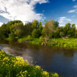 Small river under blue sky. - Stock Photo