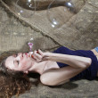 The girl inflates soap bubbles - Stock Photo