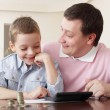 Father training the son to the finance — Stock Photo