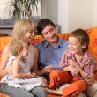 Happy family of the house on a sofa 5 — Stock Photo