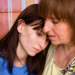 Mum regrets the daughter - Stock Photo