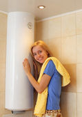 Girl about water heater — Stockfoto