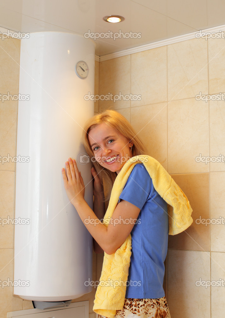 Happiness girl about a water heater  — Stock Photo #2846157