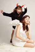 Angel and demon — Stock Photo