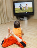 Child watching TV — Stock Photo