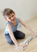 Child washing floor — Stock Photo