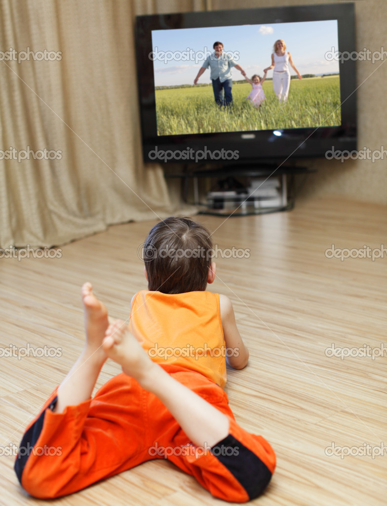Child watching TV, laying on floor  Stock Photo #2961042