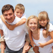 Family on the beach — Stock Photo #3376017