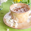 Cup of tea and spring branch - Stock Photo