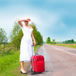 Girl in white dress with suitcase — Stock Photo