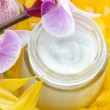 Face cream and orchid flower - Foto Stock