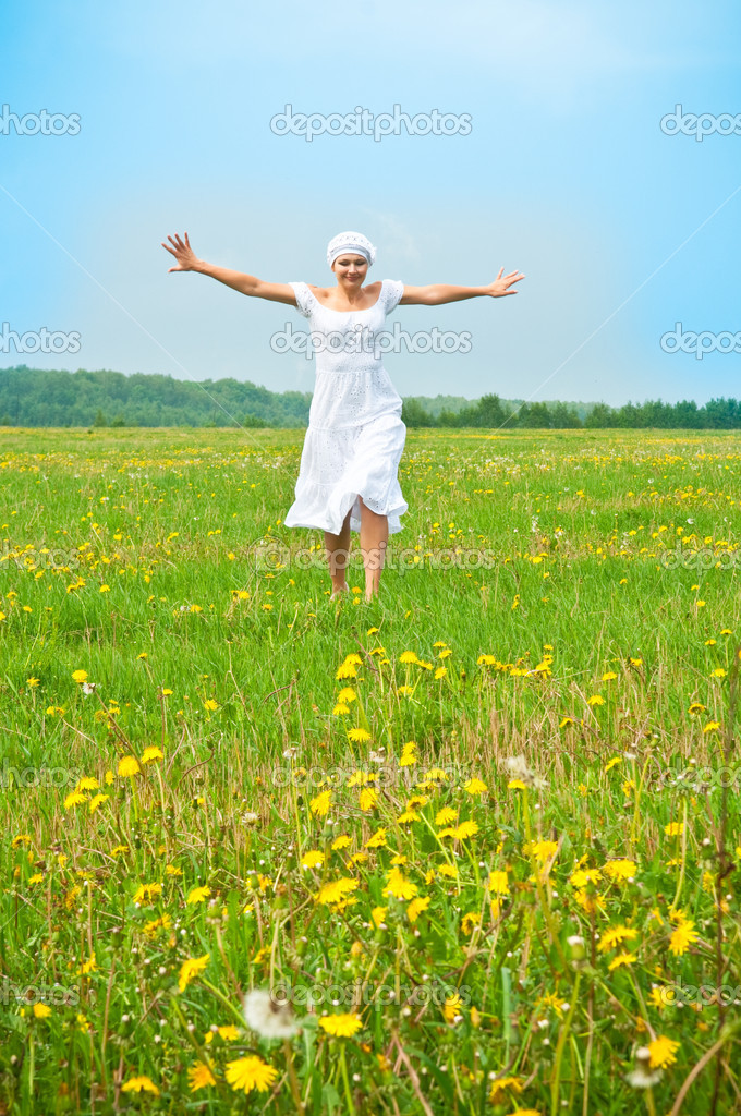 Young beautiful woman on field in summer  Stock Photo #3141102