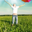 Girl under blue sky with umbrella — Stock Photo