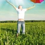 Girl under blue sky with umbrella — Stock Photo #3210904