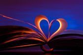 Open book in heart shape — Stock Photo