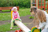 Playing on a swing — Stock Photo