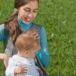 Mother and young daughter in the meadow — Stock Photo