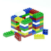 Building house is made of differend colored children's blocks — Stok fotoğraf