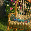 Wicker chair in the garden — Zdjęcie stockowe