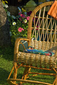 Wicker chair in the garden — Stok fotoğraf