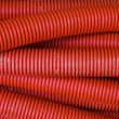 Red corrugated pipe — Stock Photo